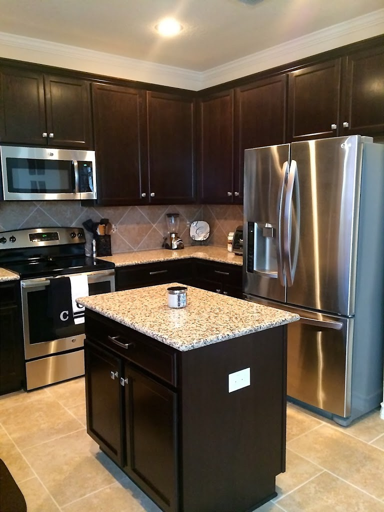 Home tour welcome to my kitchen simply clarke for Chocolate kitchen cabinets with stainless steel appliances